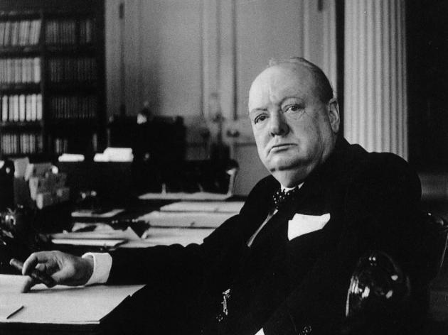 winstone-churchill-sitting-at-desk-630x472